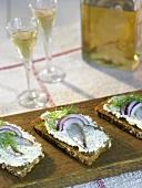 Herb quark and sprats on black bread (Sweden)