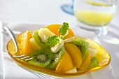 Fruit salad: peach, pineapple, kiwi fruit and banana