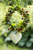 Wreath of wild strawberries with enamel heart