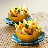 Chicory and shrimp salad in pomelos