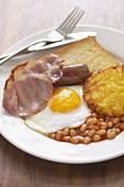 English breakfast: bacon, egg, baked beans, fried bread etc.