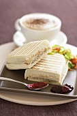 Toasted panini with cappuccino