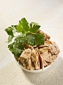 Tinned tuna in a bowl with parsley