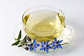 A cup of borage tea and fresh flowers