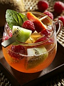 Limoncello punch with raspberries, nectarines & kiwi fruit