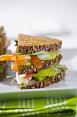Club sandwich with prawns and pears