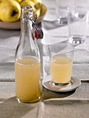 Quince juice in flip-top bottle and in glass