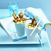 Skewered chicken with Chinese cabbage salad in beakers