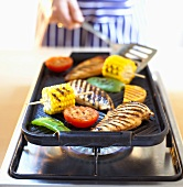 Grilling chicken breast and vegetables