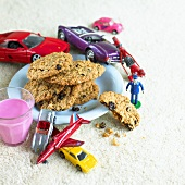 Oat and raisin biscuits, berry milk and toy cars