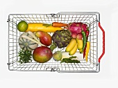 Fruit and vegetables in shopping basket (from above)