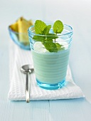 Pineapple buttermilk smoothie with mint leaves