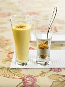 Peach and banana smoothie with nut brittle