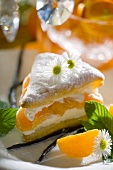 Napoleon slice filled with vanilla cream & tangerine segments