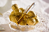 Christmas decoration: golden walnuts in glass bowl
