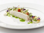 Halibut fillet garnished with edible flowers