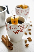 Mulled wine with clove-studded orange and cinnamon