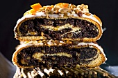 Polish poppy seed roll with icing and nuts