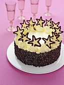 Cream cake with chocolate sprinkles and stars