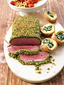 Roast beef with herb crust and filled Yorkshire puddings