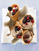 Mulled wine cream in cinnamon waffle cones with Rumtopf fruit