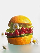 Healthy burger: courgettes, redcurrants, lettuce in an orange