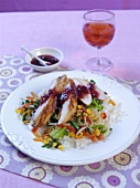 Soy chicken with cranberry sauce and vegetables on rice
