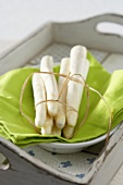 White asparagus on green cloth