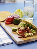 Salad leaves and sausage slices in pita bread