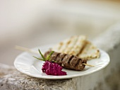 Lamb kebab with beetroot salad and pita bread (Greece)