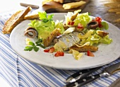 Fish salad with croutons and cheese shavings