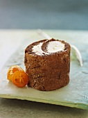 Chocolate roulade with punch cream filling and kumquats