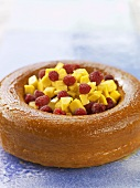 Savarin filled with mango and raspberries