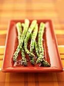 Grilled green asparagus with soy sauce and sesame seeds
