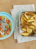 Sea bream fillet on tomato sauce, lemon & rosemary potatoes