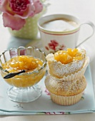 Peach jam, muffins and milky coffee