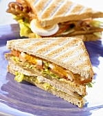 Club sandwich with chicken breast, bacon and egg