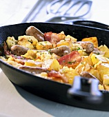 Hearty breakfast fry-up with potatoes and sausages