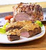 Lamb fillet with peanut cream and leg of lamb with garlic