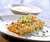 Fish fillets with macadamia crust and caper sauce