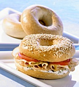 Bagel filled with herb soft cheese and turkey breast