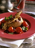 Honey-glazed pigeon with cherry tomatoes and sultanas
