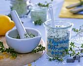 Thyme and lemon salt in jar and mortar