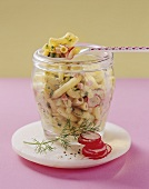 Pasta salad with ham, cheese and radishes