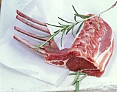 Rack of lamb with rosemary on waxed paper
