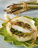 Cod on asparagus baked in pastry