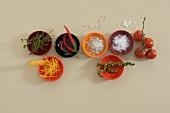 Spices, chillies, herbs, orange zest for garnishing