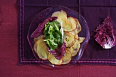 Salad leaves with fried apple slices