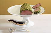 Venison fillet with herb crust and chocolate sauce