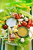 Platter of raw vegetables with two dips